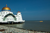 Melaka Straits Mosque or Masjid Selat Melaka, combines Middle Eastern and  Malay architecture and crafttsmanship.  The mosquefaces the Malacca Strait and is built on stilts over the water so that it looks like a floating structure if the water level is high. This mosque showcases modern Islamic architecture. Apart from serving as a place of worship, it has also become a Malacca tourist destination.