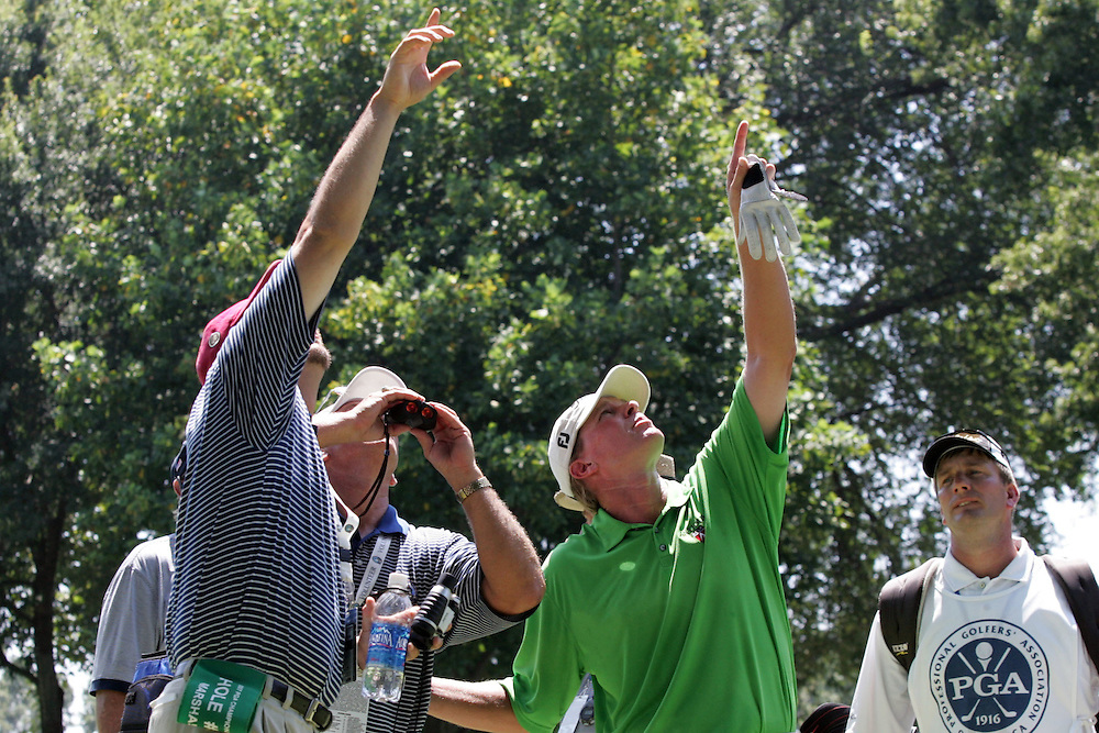 12 August 2007: Steve Stricker assists a spotter and a rules official in the location of John Daly's ball lodged in a bird's nest in a tree off the 5th fairway during the final round of the 89th PGA Championship at Southern Hills Country Club in Tulsa, OK.