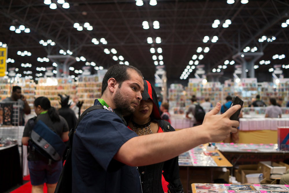 Adaina Velez poses for a selfie with a fan at Comic Con at the Javits Center in New York, NY, on Friday, Oct. 9, 2015. <br /> <br /> Photograph by Andrew Hinderaker