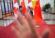 A security guard attempts to block a photographer as a picture is taken of Prime Minister Justin Trudeau being greeted by Chinese Premier Li Keqiang at the Great Hall of the People in Beijing, China on Monday, Dec. 4, 2017.The incident happened following a difference of opinion between Canadian and Chinese government staff regarding the number of foreign journalist and prime ministerial staff allowed to witness the photo opportunity. The Canadian Press/Sean Kilpatrick