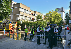© Licensed to London News Pictures. 23/08/2019. London, UK. Grenfell Tower, the scene of a tragic fire, is seen behind emergency services, at the scene where a fire has started at a flat in a tower block at Darfield Way in west London, just yards from Grenfell Tower. Photo credit: Ben Cawthra/LNP
