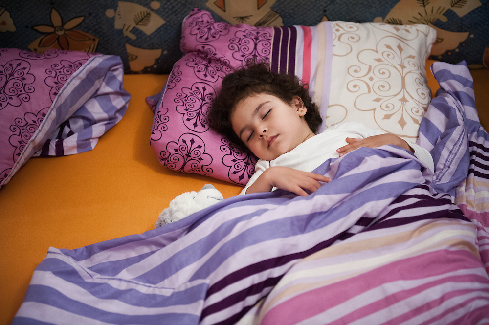 Night, Tuesday 15th of September 2015. After having a shower and a cooked supper, 3 1/2 year old Sham fells asleep in the bed in the rented apartment in Vienna.