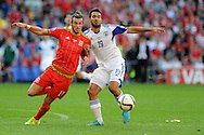 Gareth Bale of Wales holds off Israel's Orel Dgani.Euro 2016 qualifying match, Wales v Israel at the Cardiff city stadium in Cardiff, South Wales on Sunday 6th Sept 2015.  pic by Andrew Orchard, Andrew Orchard sports photography.