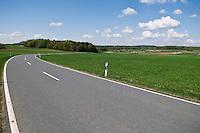 Rural country road through farm field, Upper Franconia, Bavaria, Germany