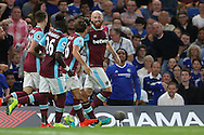 James Collins of West Ham United ® celebrates after scoring his sides 1st goal to make it 1-1 with his teammates. Premier league match, Chelsea v West Ham United at Stamford Bridge in London on Monday 15th August 2016.<br /> pic by John Patrick Fletcher, Andrew Orchard sports photography.
