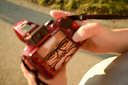 Professional photographer Geoffrey Mikol's face is reflected in the screen of his digital camera.
