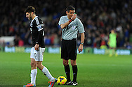 Referee Andre Marriner looks on as Southampton's Adam Lallana walks away. Barclays Premier league, Cardiff city v Southampton at the Cardiff city Stadium in Cardiff,  South Wales on Boxing day, Thursday 26th Dec 2013. <br /> pic by Andrew Orchard, Andrew Orchard sports photography.
