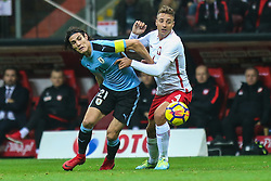 November 10, 2017 - Warsaw, Poland - Thiago Cionek (POL), Edinson Cavani (URU)  in action during the international friendly match between Poland and Uruguay at National Stadium on November 10, 2017 in Warsaw, Poland. (Credit Image: © Foto Olimpik/NurPhoto via ZUMA Press)