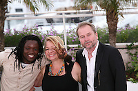 Actor Peter Kazungu, Actress Inge Maux, Director Ulrich Seidl at the photocall for the film Paradies : Liebe at the 65th Cannes Film Festival. Friday 18th May 2012 in Cannes Film Festival, France.