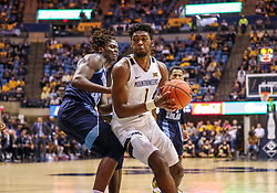 Dec 1, 2019; Morgantown, WV, USA; West Virginia Mountaineers forward Derek Culver (1) makes a move in the lane during the second half against the Rhode Island Rams at WVU Coliseum. Mandatory Credit: Ben Queen-USA TODAY Sports