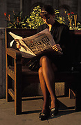 A business lady reads a 1992 edition of the Evening Standard whose headline reports on the 15% load rate after two days when Prime Minister John Major fought the Pound Crisis, in the City of London the capitals financial district, aka The Square Mile, the capitals financial centre, on 18th September 1992, in London, England. Black Wednesday occurred in the United Kingdom on 16 September 1992, when John Majors Conservative government was forced to withdraw the pound sterling from the European Exchange Rate Mechanism ERM after it was unable to keep the pound above its agreed lower limit in the ERM.