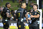 Sean Wainui of the Chiefs (centre) celebrates with teammates after scoring a try during the Round 5 Trans-Tasman Super Rugby match between NSW Waratahs and Waikato Chiefs at Brookvale Oval in Sydney, Saturday, June 12, 2021. (AAP Image/Dan Himbrechts) NO ARCHIVING, EDITORIAL USE ONLY