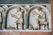 Late medieval relief sculpture depicting the labours for January and Feburary and astrological signs on the Facade of the Cattedrale di San Martino,  Duomo of Lucca, Tunscany, Italy, .<br /> <br /> Visit our ITALY HISTORIC PLACES PHOTO COLLECTION for more   photos of Italy to download or buy as prints https://funkystock.photoshelter.com/gallery-collection/2b-Pictures-Images-of-Italy-Photos-of-Italian-Historic-Landmark-Sites/C0000qxA2zGFjd_k<br /> <br /> <br /> Visit our MEDIEVAL PHOTO COLLECTIONS for more   photos  to download or buy as prints https://funkystock.photoshelter.com/gallery-collection/Medieval-Middle-Ages-Historic-Places-Arcaeological-Sites-Pictures-Images-of/C0000B5ZA54_WD0s .<br /> <br /> If you prefer to buy from our ALAMY PHOTO LIBRARY  Collection visit : https://www.alamy.com/portfolio/paul-williams-funkystock/lucca.html .
