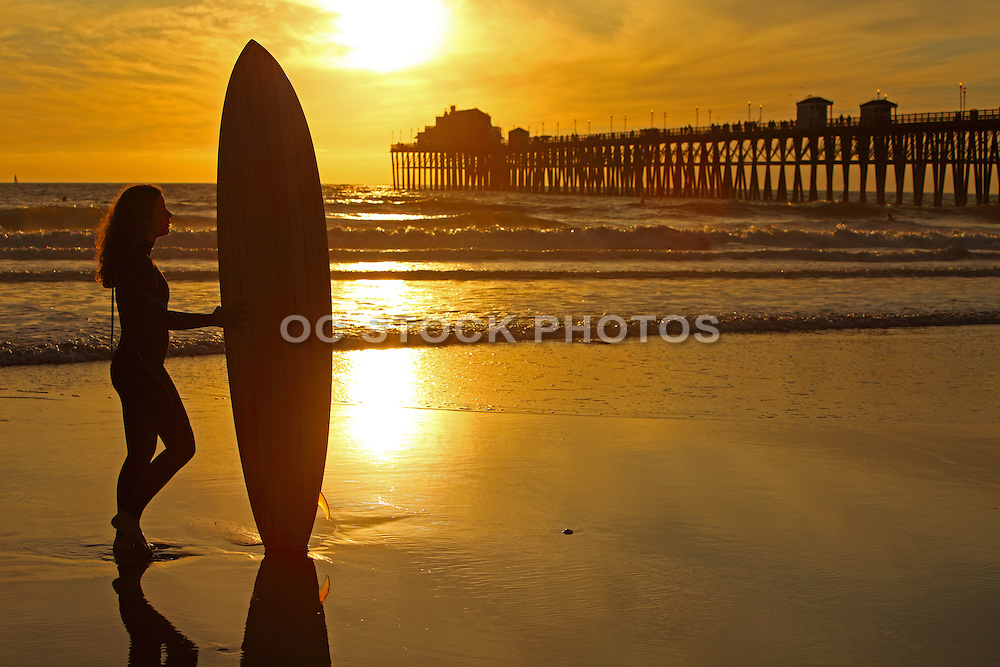 Female Surfer on the Beach at Sunset