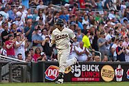 Brian Dozier #2 of the Minnesota Twins rounds the bases after hitting a home run against the Chicago White Sox on June 19, 2013 at Target Field in Minneapolis, Minnesota.  The Twins defeated the White Sox 7 to 4.  Photo: Ben Krause