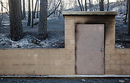 """Burned forest from the Station Fire forms a backdrop for the storage shed of a water depot in the Angeles National Forest. The demand to protect structures built in forests (the """"urban interface"""") rather than environmental concerns determines a great deal of wildfire management policy."""