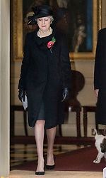 © Licensed to London News Pictures. 12/11/2017. London, UK. Prime Minister Theresa May walks from Number 10 Downing Street, watched by Larry the cat, to attend the Remembrance Sunday Ceremony at the Cenotaph in Whitehall. Photo credit: Peter Macdiarmid/LNP
