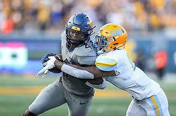 Sep 11, 2021; Morgantown, West Virginia, USA; West Virginia Mountaineers running back Leddie Brown (4) runs the ball and is tackled by Long Island Sharks safety Jerome Brooks III (6) during the second quarter at Mountaineer Field at Milan Puskar Stadium. Mandatory Credit: Ben Queen-USA TODAY Sports