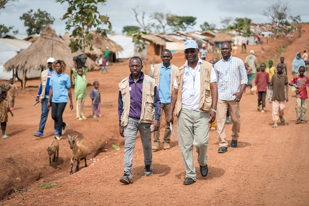 3 June 2019, Djohong, Cameroon: Staff of the Lutheran World Federation World Service programme walk through the Borgop refugee camp, under the leadership of Mathieu Idjawo (first line, right), project coordinator of 'Strengthened Livelihoods and Social Cohesion for Central African Republic refugees and host communities in Cameroon'. The Borgop refugee camp is located in the municipality of Djohong, in the Mbere subdivision of the Adamaoua regional state in Cameroon. Supported by the Lutheran World Federation since 2015, the camp currently holds 12,300 refugees from the Central African Republic.