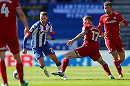 Nick Powell of Wigan Athletic goes past Aron Gunnarsson of Cardiff City. EFL Skybet Championship match , Wigan Athletic v Cardiff city at the DW Stadium in Wigan, Lancs on Saturday 22nd April 2017.<br /> pic by Chris Stading, Andrew Orchard sports photography.