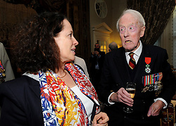Veteran Humphrey Tottenham, 94, from Wiltshire, talks to French Ambassador Sylvie Bermann after she presented him with the Legion d'honneur, France's highest distinction, for his role in liberating France during the Second World War, during a ceremony at the Ambassador's residence in Kensington, London.