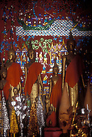 art and buddhas in a temple in Luang Prabang, Laos, a UNESCO World Heritage Center.