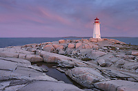 Dramatic sunrise at Peggy's Cove Lighthouse heralds in approaching storm,  Nova Scotia