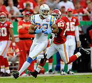 October 25, 2009:   Wide receiver Vincent Jackson #83 of the San Diego Chargers rushes up field after catching a 51-yard pass in the second quarter past defensive back Mike Richardson #23 of the Kansas City Chiefs at Arrowhead Stadium in Kansas City, Missouri.  The Chargers defeated the Chiefs 37-7...