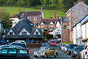 Motoring in a Vintage Riley 3 litre saloon car through the old medieval town of Dunster, in Somerset, UK
