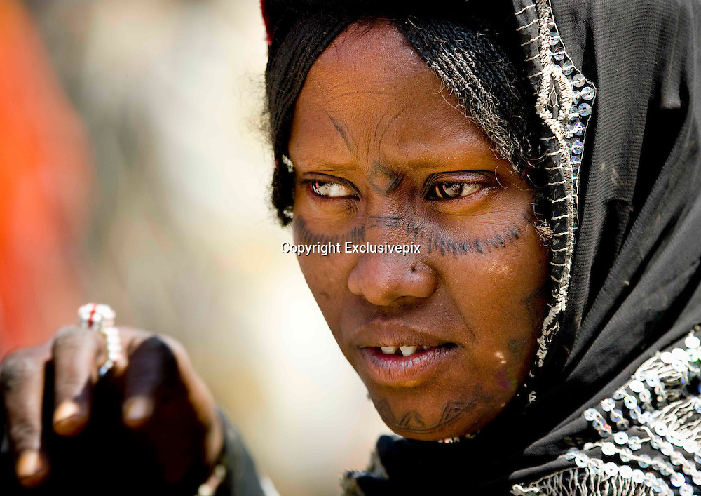Are these the world's most painful tattoos? Ethiopian and Sudanese tribes show off their intricate raised patterns created using THORNS<br /> <br /> From delicate swirls of raised flesh to intricate dotted patterns, the scars that decorate the bodies of Ethiopia's Bodi, Mursi and Surma tribes are more than just the sign of an old injury.<br /> <br /> For these aren't just any scars: They're an elaborate part of local culture and signify everything from beauty to adulthood or even, in some cases, are simply a mark of belonging.<br /> <br /> But Ethiopian tribes aren't the only ones to embrace scarification. In Uganda, the Karamojong are famous for their elaborate scar patterns, while across Ethiopia's border with Sudan, Nuer men bear scarred foreheads and consider getting them a key part of the transition from boy to man. Now the stunning scar markings of Ethiopia and Sudan are the subject of an incredible set of photographs by French snapper, Eric Lafforgue, who travelled through the country observing cutting ceremonies and meeting the locals.<br /> <br /> During a visit to the Surma tribe, who live in the country's remote Omo Valley, he witnessed a scarification ceremony, which involved creating the patterns using thorns and a razor.<br /> <br /> 'The12-year-old girl who was being cut didn't say a word during the 10-minute ceremony and refused to show any pain,' he revealed. 'Her mother used a thorn to pull the skin out and a razor blade to cut the skin.<br /> <br /> 'At the end, I asked her whether having her skin cut had been tough and she replied that she was close to collapse. It was incredible as she didn't show any sign of pain on her face during the ceremony as that would have been seen as shameful for the family.'<br /> <br /> What's more, he explained, despite the pain, the girl herself initiated the ceremony as Surma girls aren't obliged to take part. 'Scars are a sign of beauty within the tribe,' he added.<br /> <br /> 'Children who go to school or conve
