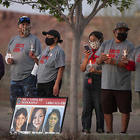 The family of Laverda Guy Sorrell participates in a candlelight vigil following a six mile walk to Tséhootsooí Middle School in Fort Defiance, Arizona Wednesday in honor of Missing and Murdered Indigenous Persons Awareness Day. Tséhootsooí Middle School was the last place Laverda Guy Sorrell was seen in 2002 when she went missing.