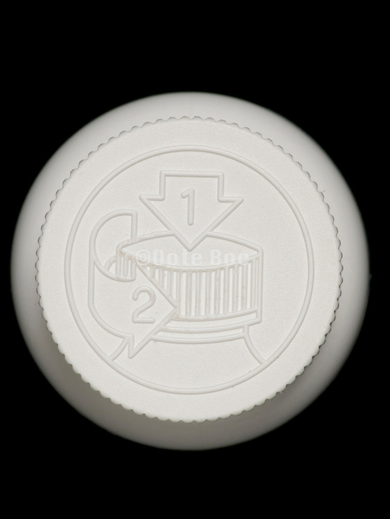 overhead view of an safety lid on a medicine bottle