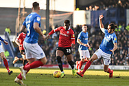Barnsley Forward, Mamadou Thiam (26) tackled bt Portsmouth Defender, Christian Burgess (6) during the EFL Sky Bet League 1 match between Portsmouth and Barnsley at Fratton Park, Portsmouth, England on 23 February 2019.