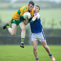 O'Curry's Jim Marrinan in action against St. Senan's Kilkee's Gearoid Lynch