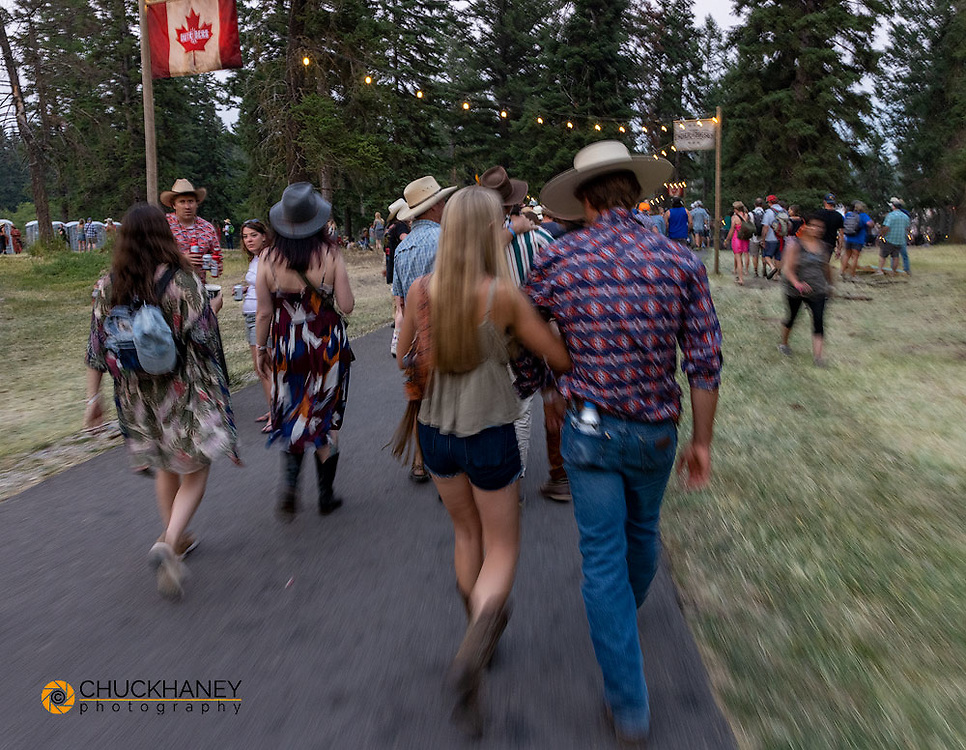Crowd moving from one stage to another at the Under The Big Sky Music Festival in Whitefish, Montana, USA