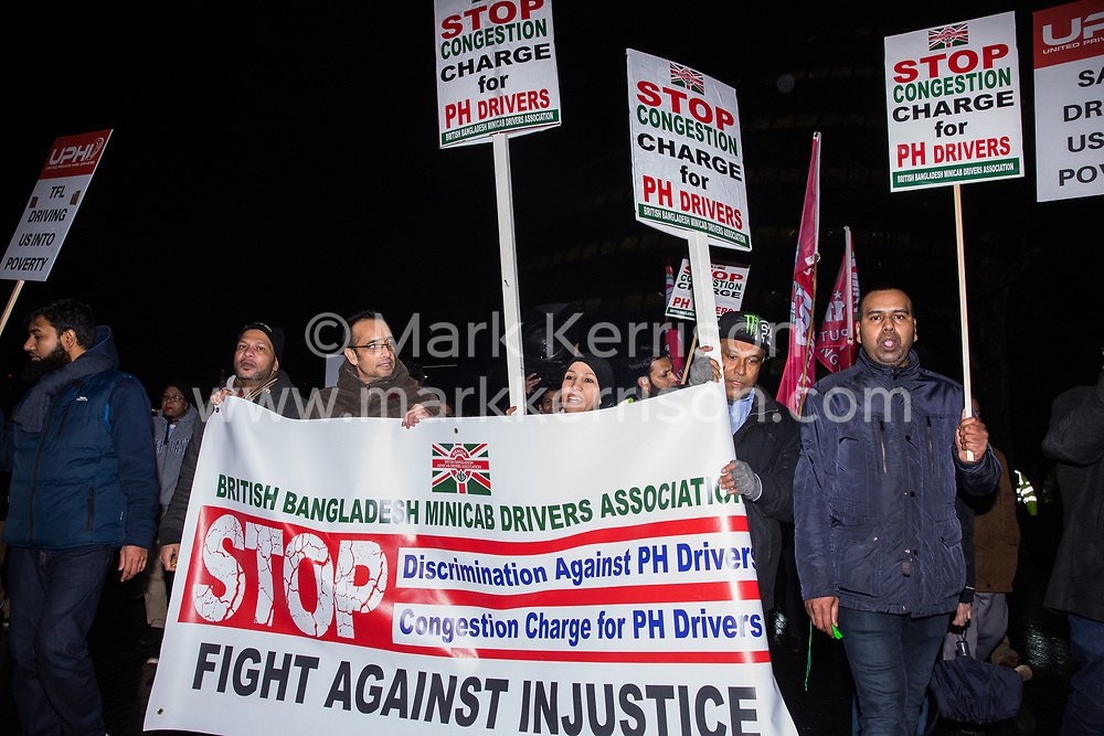 London, UK. 4th February, 2019. Hundreds of Uber minicab drivers march around Southwark after having protested outside City Hall and having left their vehicles blocking London Bridge as part of a demonstration organised by the United Private Hire Drivers (UPHD) branch of the Independent Workers Union of Great Britain's (IWGB)  following the introduction in December of congestion charges for minicabs.
