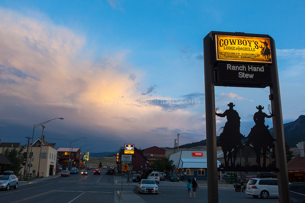 """Restaurant sign at Cowboy's Lodge and Grille, Gardiner, Montana, the north west gateway town to Yellowstone National Park, with a rainstorm commencing in the background. This mage can be licensed via Millennium Images. Contact me for more details, or email mail@milim.com For prints, contact me, or click """"add to cart"""" to some standard print options."""