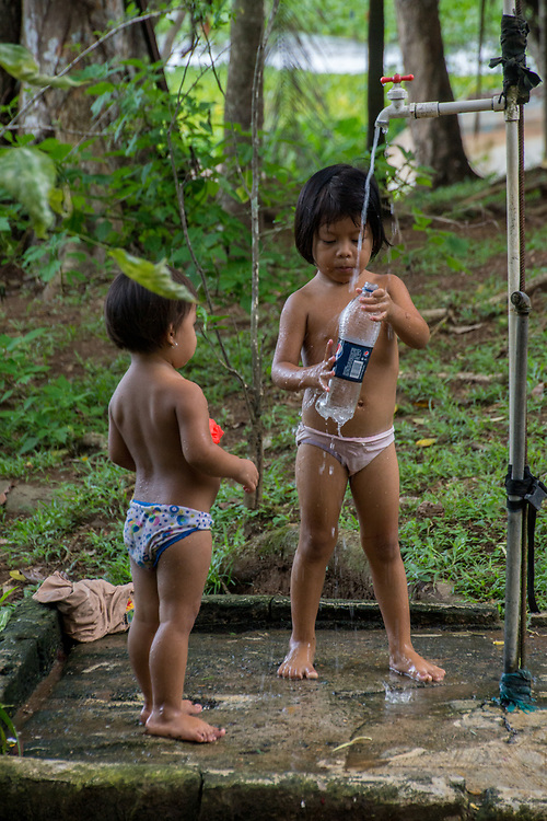 Two Embera Indian children play in a wooded area. Photo by Adel B. Korkor.