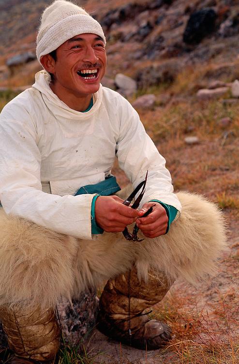 Inuit Narwhal hunter Storm Uudaq, with Polar Bear skin pants, Qaanaaq NW Greenland, Arctic