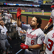 NEW YORK, NEW YORK - July 07: Anthony Rendon #6 of the Washington Nationals is congratulated by team mates as he returns to the dugout after hitting a solo home run in the fourth inning during the Washington Nationals Vs New York Mets regular season MLB game at Citi Field on July 07, 2016 in New York City. (Photo by Tim Clayton/Corbis via Getty Images)