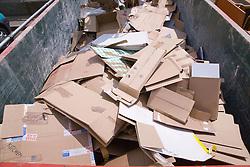 Skip full of cardboard at city tip,