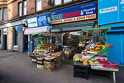 Green Grocers shop selling fruit and vegetables on Victoria Road in Govanhill district of Glasgow, Scotland, United Kingdom