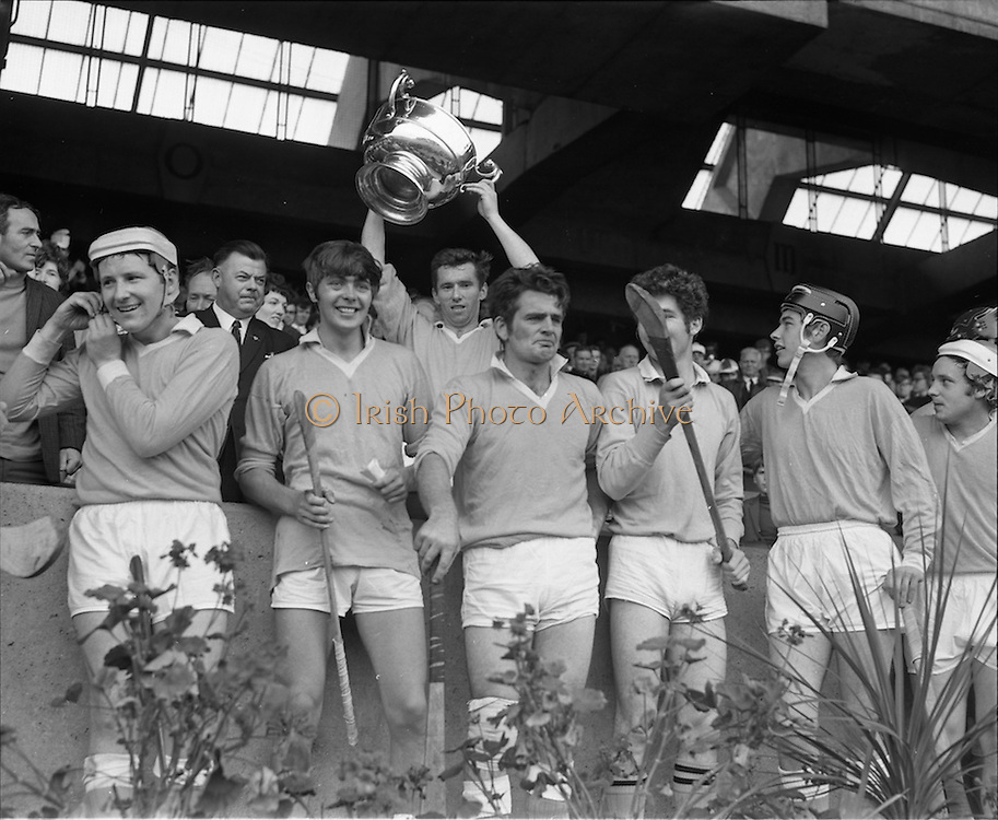 04/10/1970<br /> 10/04/1970<br /> 10 April 1970<br /> All-Ireland Intermediate Hurling Final: Antrim v Warwickshire at Croke Park, Dublin.<br /> Surrounded by his teammates, Antrim Captain, Sean Burns (center), holds the cup high after they won the All-Ireland Intermediate Hurling Final.