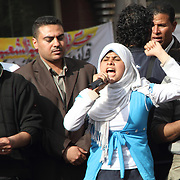 A young, veiled woman gives an impassioned address to the protesters during the Day of Justice and Cleansing in Cairo's Tahrir Square.