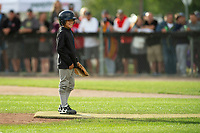 KELOWNA, CANADA - JUNE 28: A young baseball player stands on the pitchers mound to throw the opening pitch during the opening charity game of the Home Base Slo-Pitch Tournament fundraiser for the Kelowna General Hospital Foundation JoeAnna's House on June 28, 2019 at Elk's Stadium in Kelowna, British Columbia, Canada.  (Photo by Marissa Baecker/Shoot the Breeze)