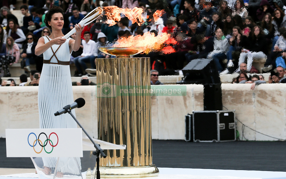 ATHENS, Oct 31, 2017  Actress Katerina Lehou playing the role of high priestess lights an Olympic torch during the handover ceremony for the Olympic Flame at Panathenaic stadium in Athens, on Oct. 31, 2017, The Flame burning for the 2018 PyeongChang Winter Olympics was handed over on Oct. 31 to the South Korean organizers in a touching ceremony. (Credit Image: © Marios Lolos/Xinhua via ZUMA Wire)