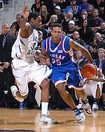 Kansas guard Brandon Rush (25) drives past Kansas State guard Akeem Wright (34) in the first half at Bramlage Coliseum in Manhattan, Kansas, February 19, 2007.
