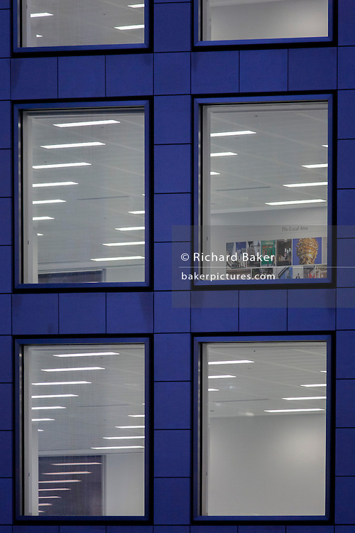 Internal lighting seen in a still vacant office space in the City of London, UK.