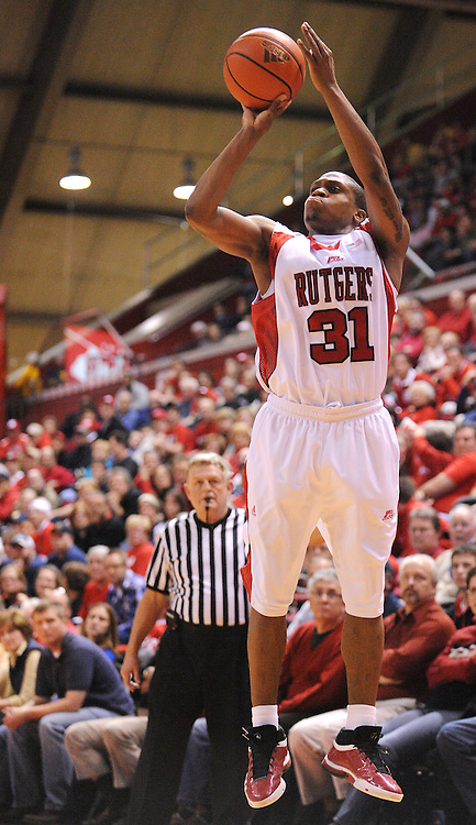 Feb 22, 2009; Piscataway, NJ, USA; Rutgers guard Mike Coburn (31) takes a three-point shot during the second half of Rutgers' 74-56 loss to West Virginia at the Louis Brown Athletic Center.