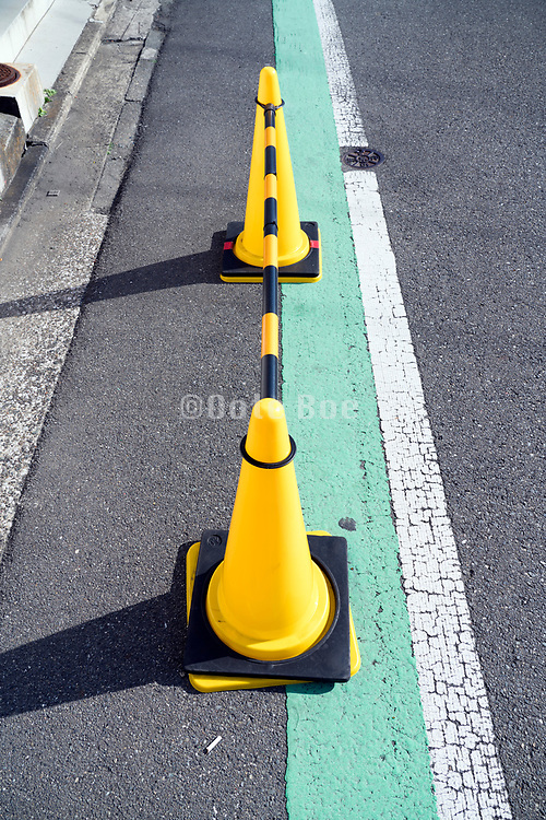 cones with bar blocking part of a road Japan